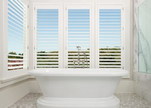 Hunter Douglas, New style shutter, shutter, plantation shutter, rear tilt bar, white shutterws, single panel shutters, white and gray bathroom, white tub