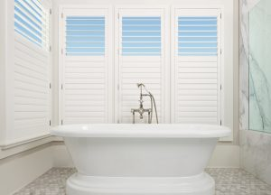 Hunter Douglas, Plantation shutters, shutters, white shutter, rear tilt bar, split rear tilt bar, white bath tub, gray and white bathroom, shades and blinds