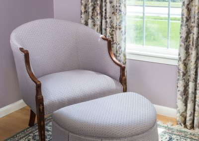 Reupholstered-chair-and-custom-ottoman-Northboro-Interior--design